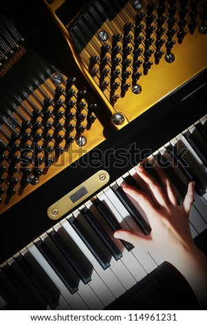 Piano music pianist hands playing. Musical instrument grand piano details with performer hand on white background - stock photo