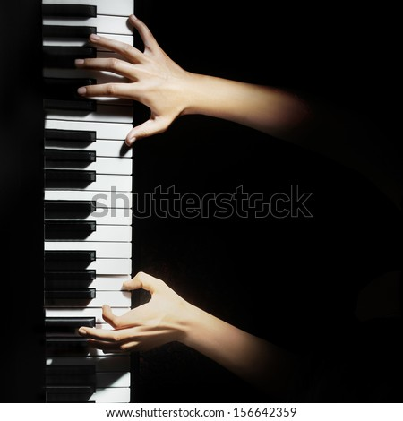 Piano music pianist hands playing. Musical instrument grand piano details with performer hand on black background - stock photo