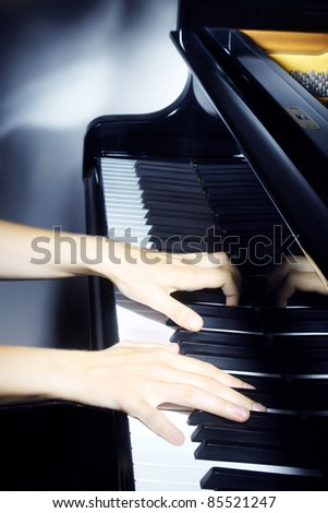Piano pianist hands playing music. Musical instrument grand piano details with performer hands - stock photo