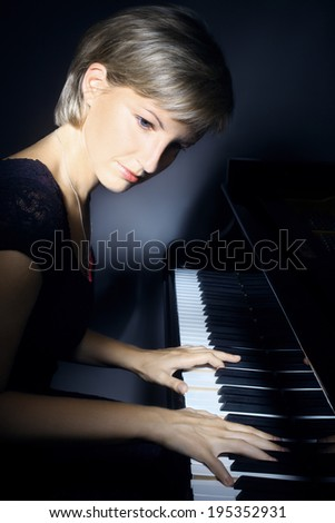 Piano player pianist playing. Musical instrument grand piano classical music concert - stock photo
