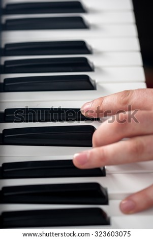 Piano playing, close-up on fingers