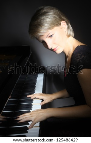 Piano playing pianist player. Woman with classical musical instrument - stock photo