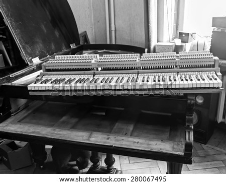 Piano restoration photo in black and white colors - stock photo