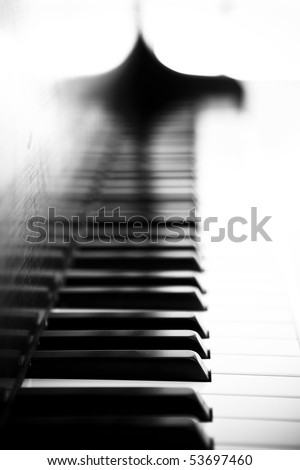 Piano side view with keys lost in the light. - stock photo