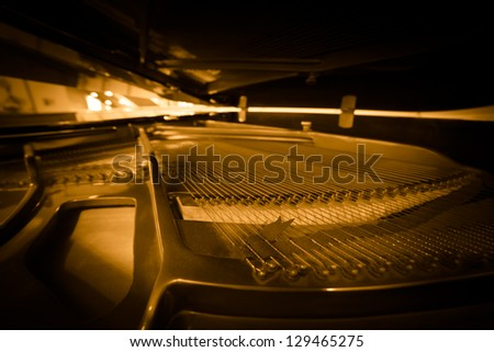 Piano strings and hammer detail - stock photo