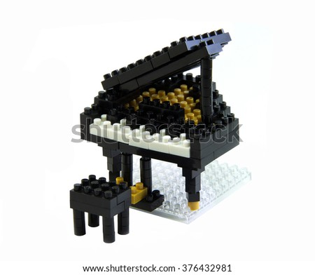 Piano toy made from plastic toy blocks isolated on white background - stock photo