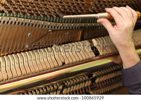 Piano tuning process - stock photo