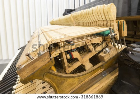 piano tuning, repairing the vintage piano - stock photo
