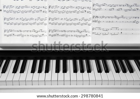 Piano with music notes close up - stock photo