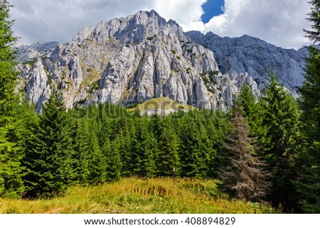Piatra Craiului Mountains are a mountain range in the Southern Carpathians in Romania - stock photo