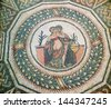 PIAZZA ARMERINA, SICILY, ITALY - APRIL 3: Mosaics in archaeological Site Villa Romana del Casale on April 3, 2004. Largest collection of Roman mosaics in the world, it is UNESCO World Heritage Sites. - stock photo