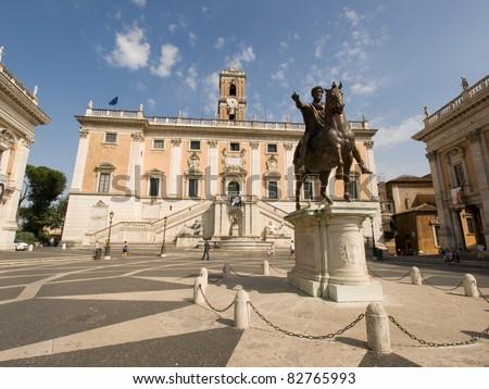Piazza del Campidoglio, on the top of Capitoline Hill, with the fa?ade of Palazzo Senatorio and the replica of the equestrian statue of Marcus Aurelius. - stock photo