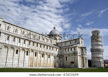 Piazza del Duomo (Piazza dei Miracoli) with famous landmarks of Pisa - Duomo cathedral and leaning tower. It is UNESCO World Heritage Site. - stock photo