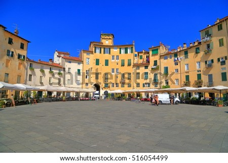 Piazza dell'Anfiteatro surrounded by terraces and medieval buildings in Lucca, region of Tuscany, Italy