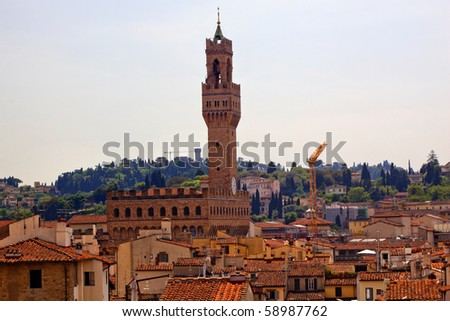 Piazza della Signoria Palazzo Vecchio Arnolfo Tower Terra Cotta Rooftops from Giotto's Bell Tower Florence Italy Countryside in Background Built in 1293 Home of the Medici, Seat of Government - stock photo