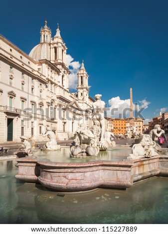 Piazza Navona in Rome and Fountain of the Moor - stock photo