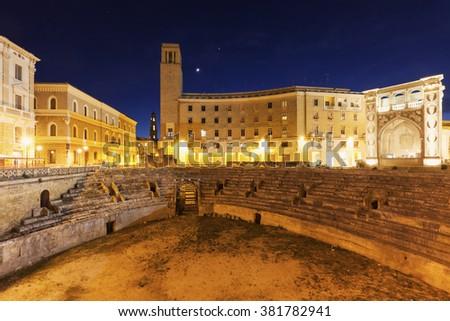 Piazza Santo Oronzo and Roman Amphitheatre in Lecce. Lecce, Apulia, Italy - stock photo