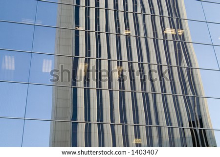 Picasso Tower, Madrid, reflected in a building. - stock photo