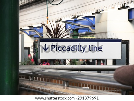 PICCADILLY LINE UNDERGROUND SIGNBOARD - stock photo