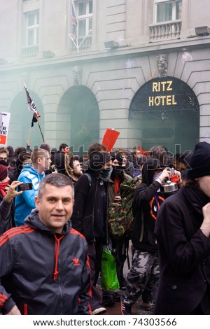 PICCADILLY, LONDON - MARCH 26: Breakaway demonstrators vandalise the Ritz hotel during protests against public sector funding cuts in central London on 26th March 2011.