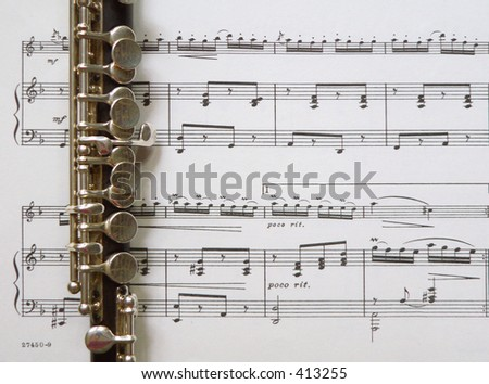 Piccolo and Sheet Music - stock photo