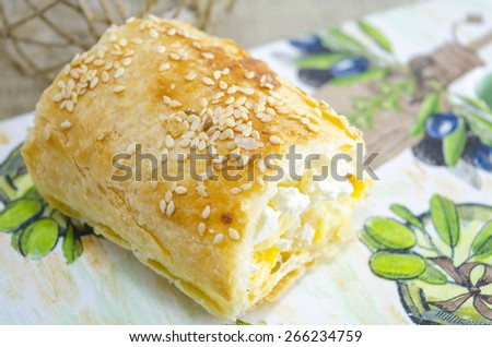Pice of homemade cheese pie on a decorated tray - stock photo