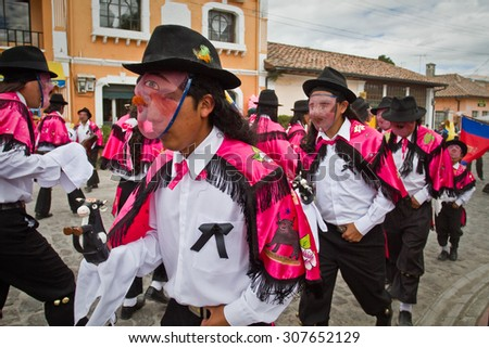 PICHINCHA, ECUADOR - JUNE 27, 2011: Unidentified dancers with elaborate costume at Inti Raymi indigenous celebration in Alangasi, Ecuador