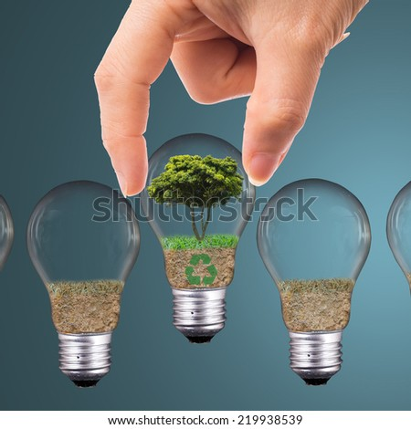 Pick recycle and protect environment with your hand  - stock photo