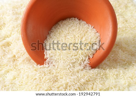 pick up of rice with a ceramic bowl - stock photo