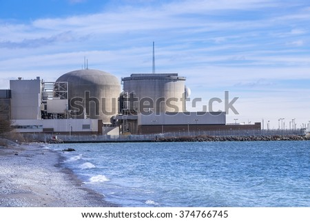 Pickering Nuclear Generating Plant, as seen from the shore of Lake Ontario, is located in  Pickering a city just outside of Toronto Canada. - stock photo