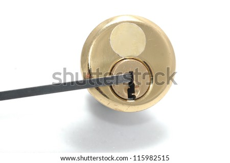 Picking a pin-tumbler lock with a tension wrench - stock photo