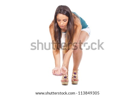 picking a speck up off the floor, on white background - stock photo