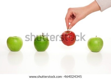 Picking different apple among similar on white