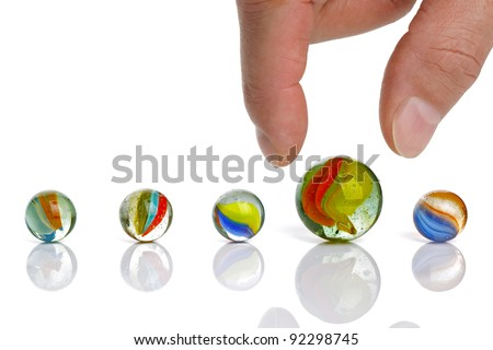 Picking up a big marble concept for choice or advantage - stock photo