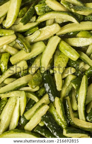 Pickled cucumbers and pepper as a background before placing in a jar - stock photo
