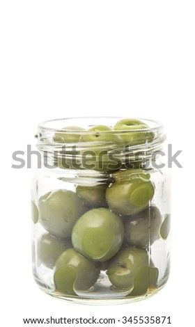 Pickled green olive fruit in mason jar over white background