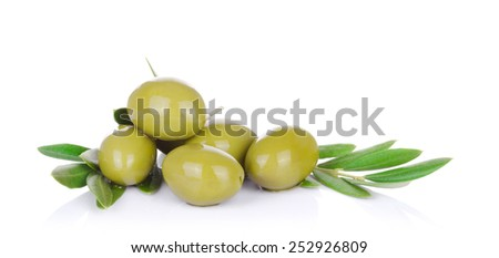 pickled green olives  and olive tree branch on a white background - stock photo
