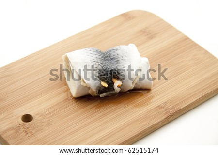 Pickled herring on edge board - stock photo