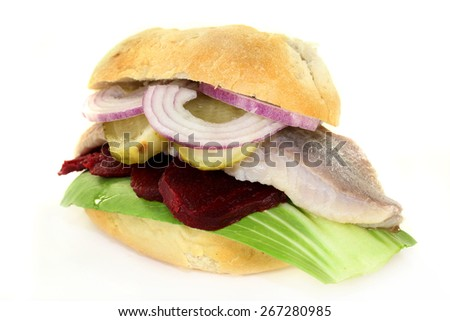 Pickled herring sandwiches with onion, beetroot and pickled cucumber - stock photo