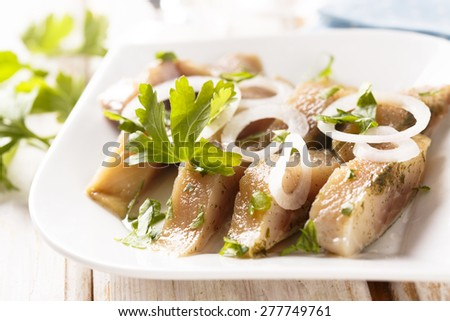 Pickled herring with onion - stock photo