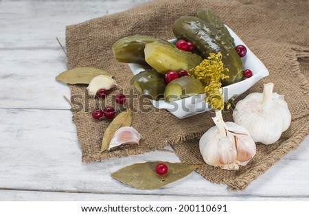 Pickled homemade cucumbers with cranberries
