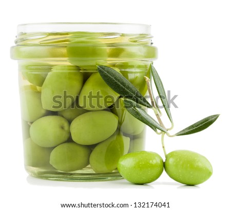 Pickled olives in glass jar and fresh olives on the branch  with leaves  isolated on a white background. - stock photo