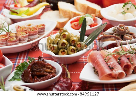 Pickled olives with other mediterranean appetizer food - stock photo