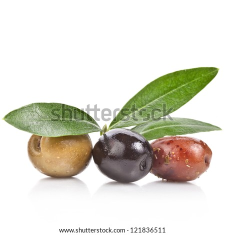 pickled olives with spices and olive tree leaves close up isolated on white background   - stock photo