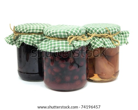 pickled pear,  plum jam and preserved cherries in glass jars on white background - stock photo