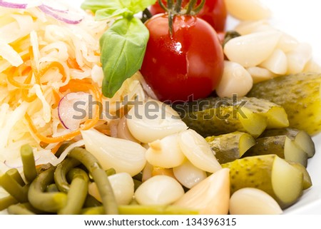 pickled vegetables, cucumber tomatoes asparagus and garlic cabbage - stock photo