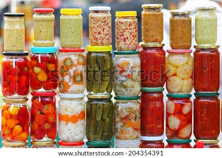 Pickled vegetables in mason jars ready for winter - stock photo