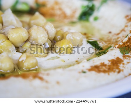 Pickles (olives, carrot and yellow cauliflower) on a white plate and a blue table - close up - stock photo