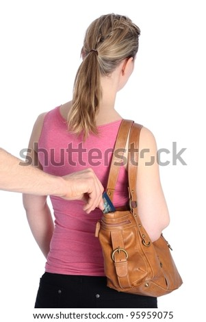 Pickpocketing a Credit card out of a handbag of a woman - stock photo