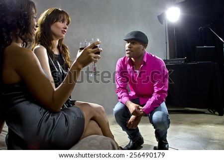 pickup artists harrassing women at a nightclub - stock photo